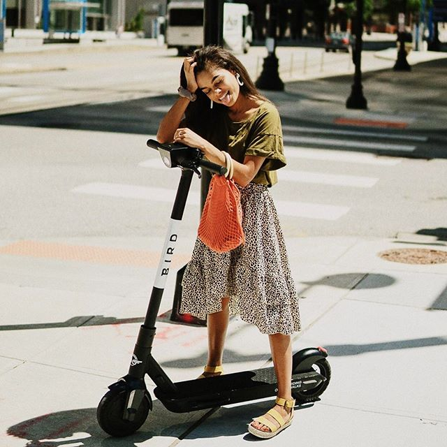 Bird scooter and young lady