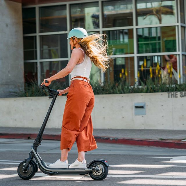 Girl rider on electric scooter