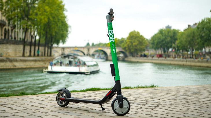 electric scooter beside a river