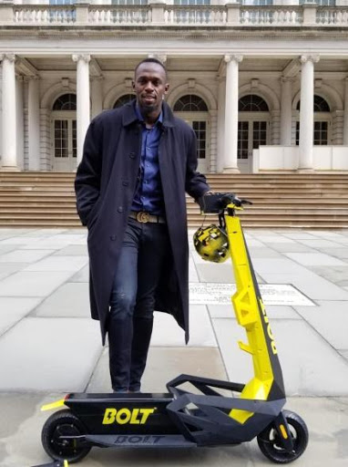 Usain Bolt with Bolt scooter