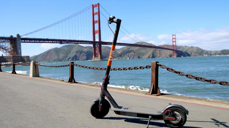 Spin Scooter and San Francisco Bay Bridge