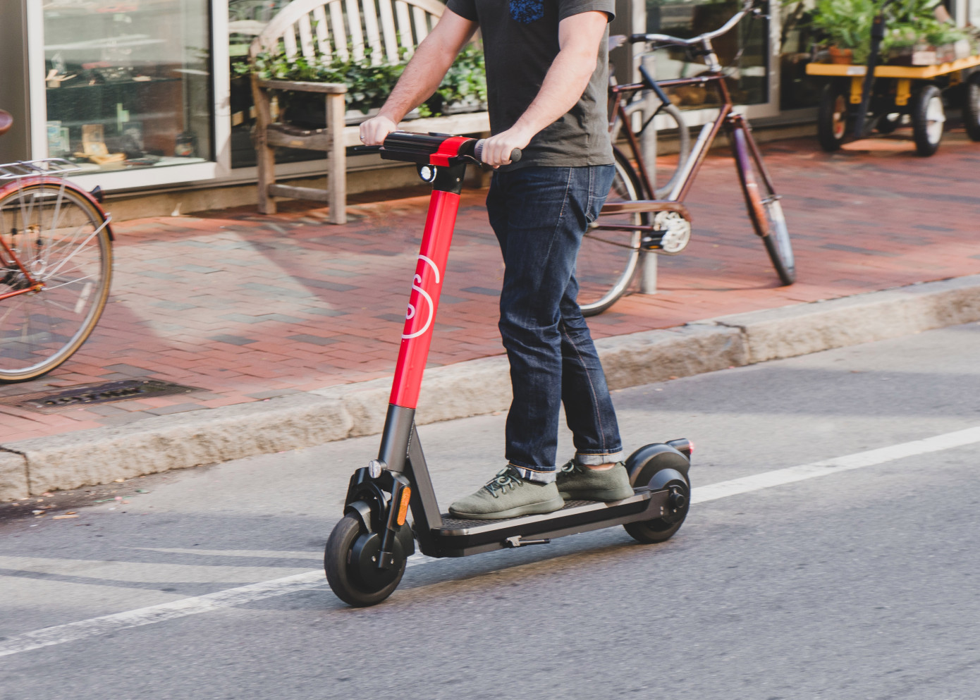 A scooter rider takes an autonomous maintenance scooter for a spin