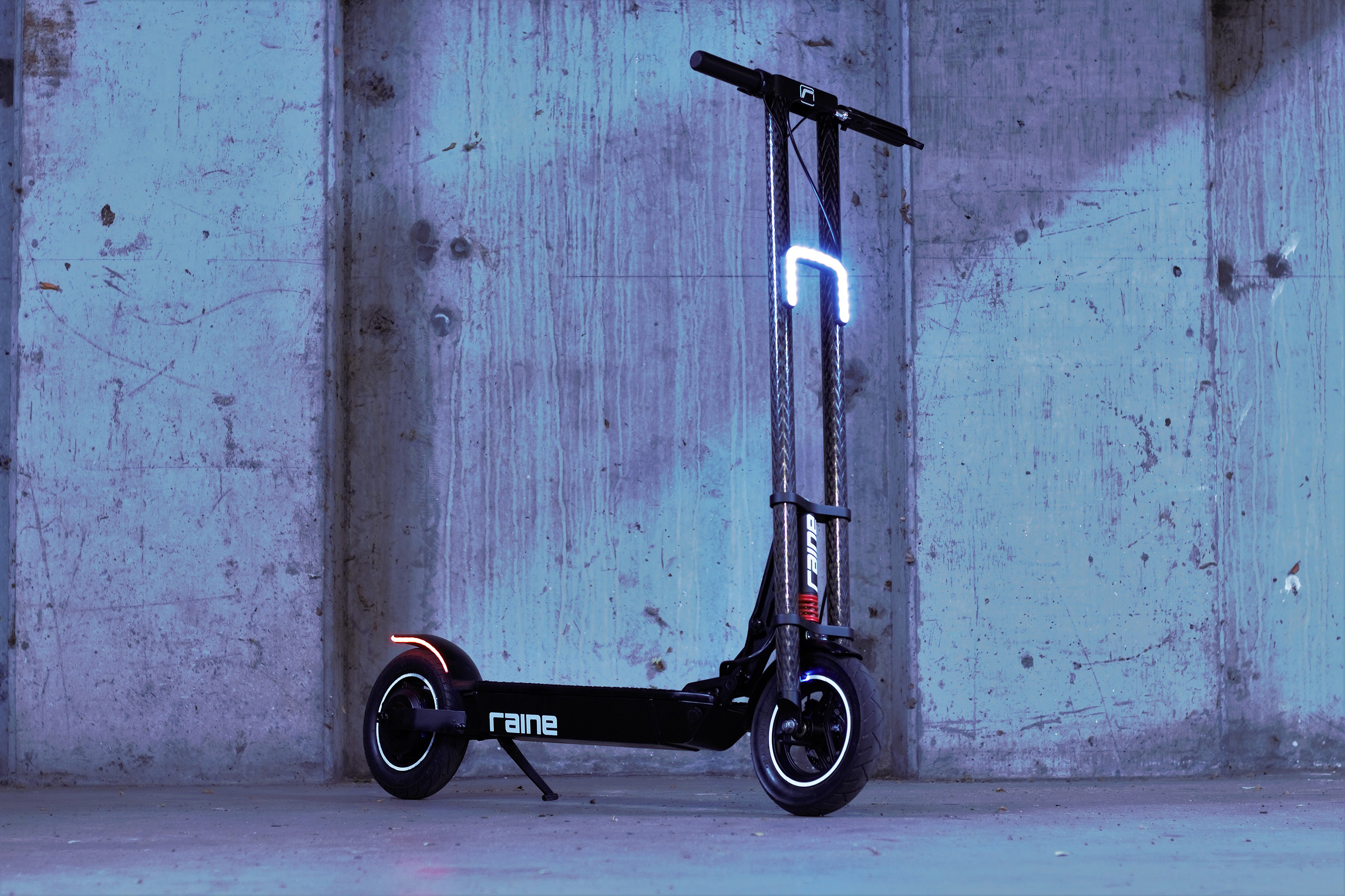 Raine electric scooter's carbon fiber neck is a dual threat of looks and strength..